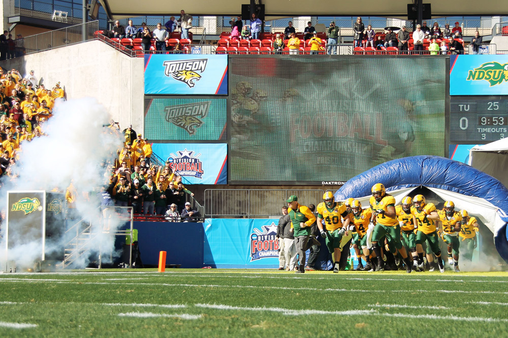 TIFFANY SWANSON | THE SPECTRUM The Bison take the field at the beginning of the championship game, led by coach Craig Bohl in his final game with NDSU.
