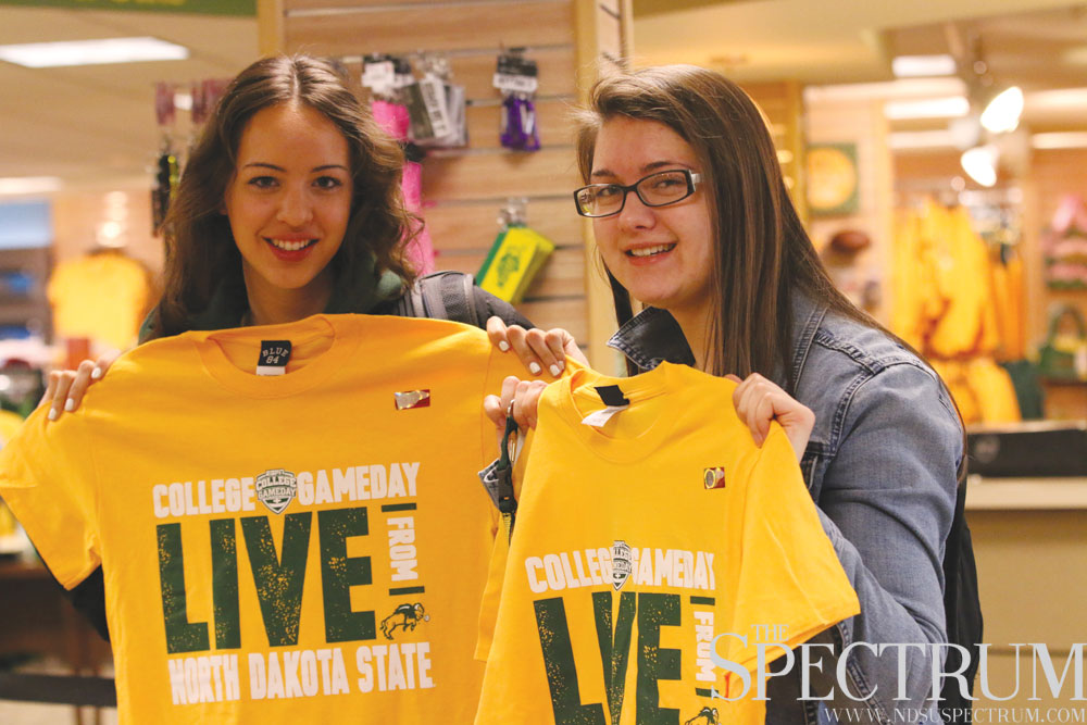"EDWARD PAVEK | THE SPECTRUM Left to right: Claire Willenbring and Kaitlyn Murphy buy shirts for the Bison ""GameDay"" event."