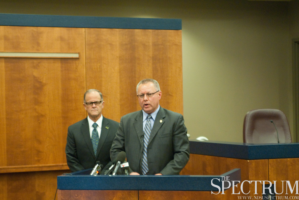 BENJAMIN NORMAN | THE SPECTRUM President Bresciani, left, and Fargo Police Chief Keith Ternes address the media regarding the body believed to be Thomas Bearson's. The body was found Tuesday morning.