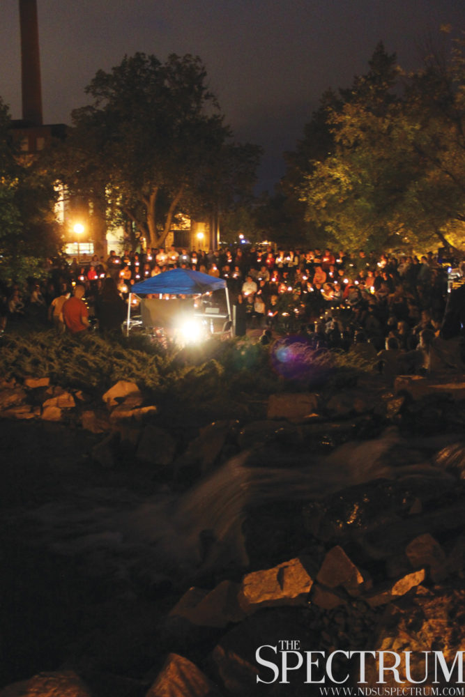 GABBY HARTZE | THE SPECTRUM The North Dakota State community gathered by the Babbling Brook celebrating Thomas Bearson's life Tuesday night.