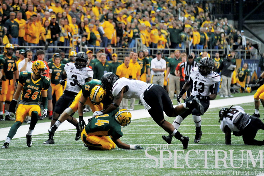 JOSEPH RAVITS | THE SPECTRUM Special teams players from both teams go after a loose ball during NDSU's 38-10 victory over SIU on Saturday.