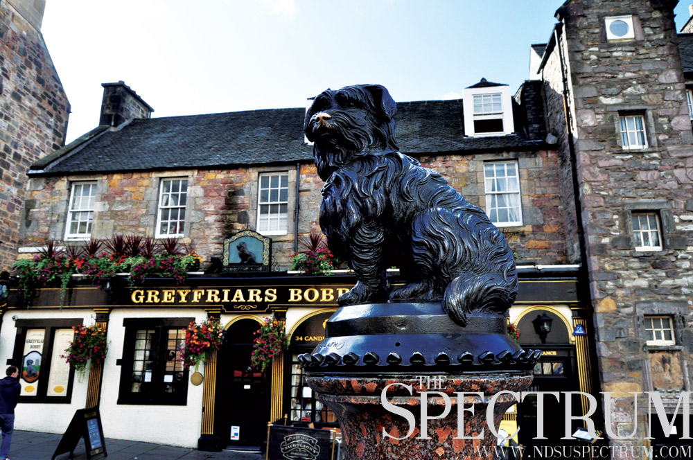 LINDA NORLAND | THE SPECTRUM A statue of a skye terrier greets potential customers outside the Greyfriars Bobby.