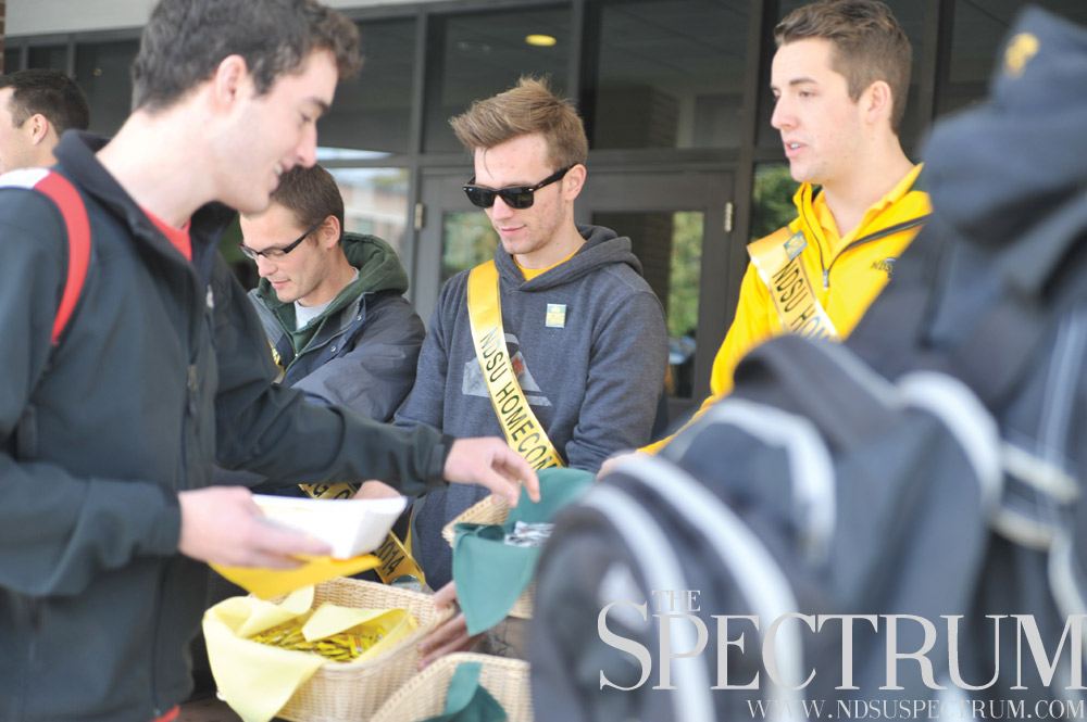 JOSEPH RAVITS   THE SPECTRUM Homecoming candidate Kyle Mason feeds students, staff and faculty alongside fellow court members Monday outside of the Memorial Union.