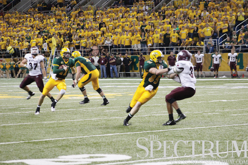 FILE PHOTO | THE SPECTRUM Quarterback Carson Wentz (11), pictured here against Montana, caught a 16-yard touchdown pass from running back John Crockett to ignite NDSU's win at Western Illinois.