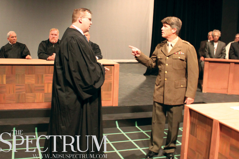 "GABBY HARTZE | THE SPECTRUM Colonel Parker (Craig Roath) and Oskar Rolfe (Reid Strand) share a tense moment in the courtroom in ""Judgment at Nuremberg."""
