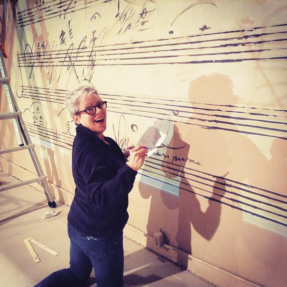 "THEATRE B |PHOTO COURTESY Linda Boyd, executive director the F-M Symphony, paints the Diabelli Variations onto the set of Theatre B's ""33 Variations."""