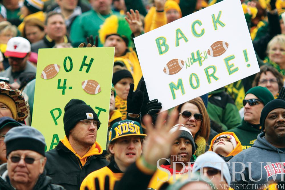 Bison fans holding signs