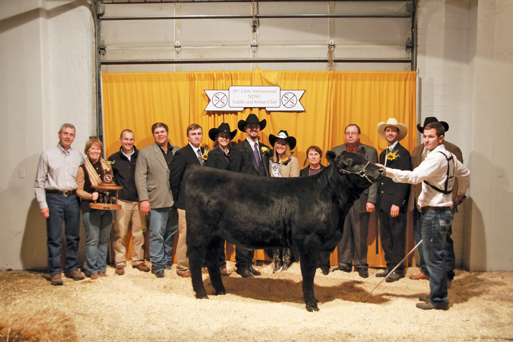 LITTLE INTERNATIONAL | PHOTO COURTESY Participants gather around a winning cow at the 88th Annual Little International in 2014.