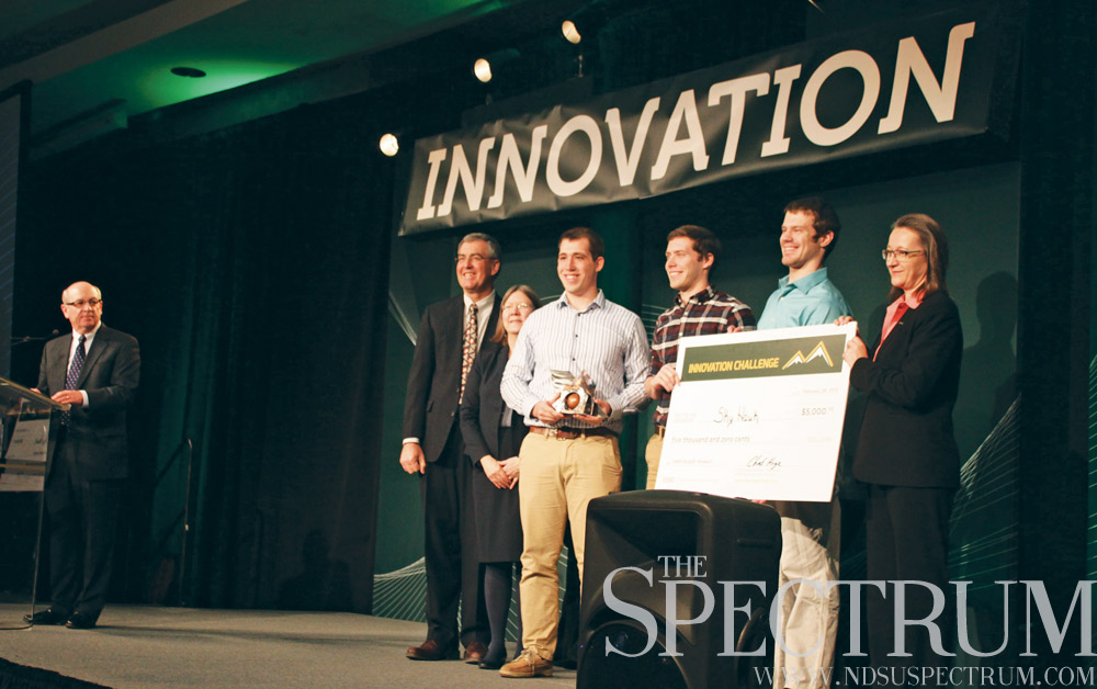 BENJAMIN NORMAN | THE SPECTRUM A $5,000 check is presented to Team SkyHawk. Five undergraduate engineering majors won the product category in the 2015 Innovation Challenge.