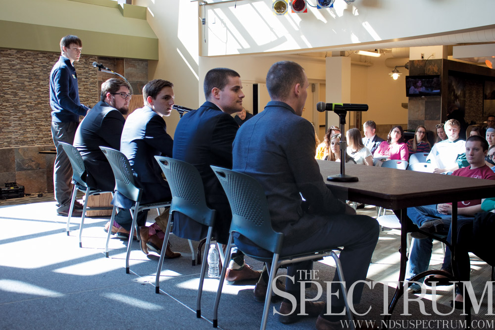 GABBY HARTZE | THE SPECTRUM Candidates (right to left) Josh Fergel, Eric McDaniel, Aaron Weber and Robert Kringler tell students what they would bring to the president and vice president position.