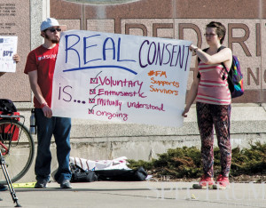 KIMBERLY HILL | THE SPECTRUM Protesters lined Veterans Memorial Bridge Tuesday, voicing their discontent toward 'rape culture' in America.