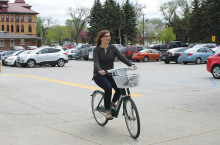 ERICA NITSCHKE | THE SPECTRUM Freshman zoology major Kelsey Erlien leaves the Memorial Union Friday afternoon on a Bike Share bike.