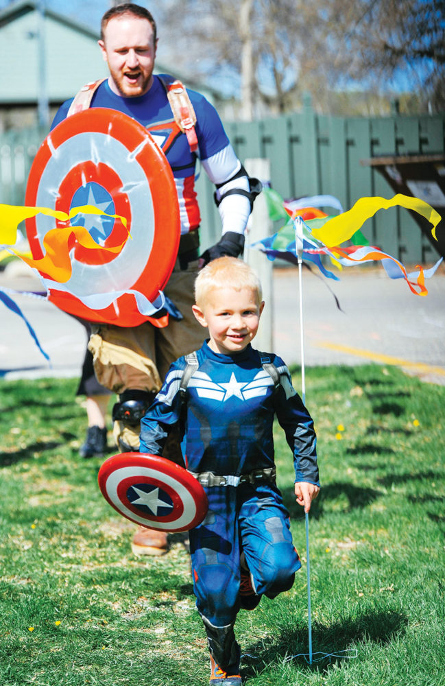 JOSEPH RAVITS | THE SPECTRUM Parents and children alike dressed as superheroes Saturday morning to celebrate race day and, coincidently, National Comic Book Day.