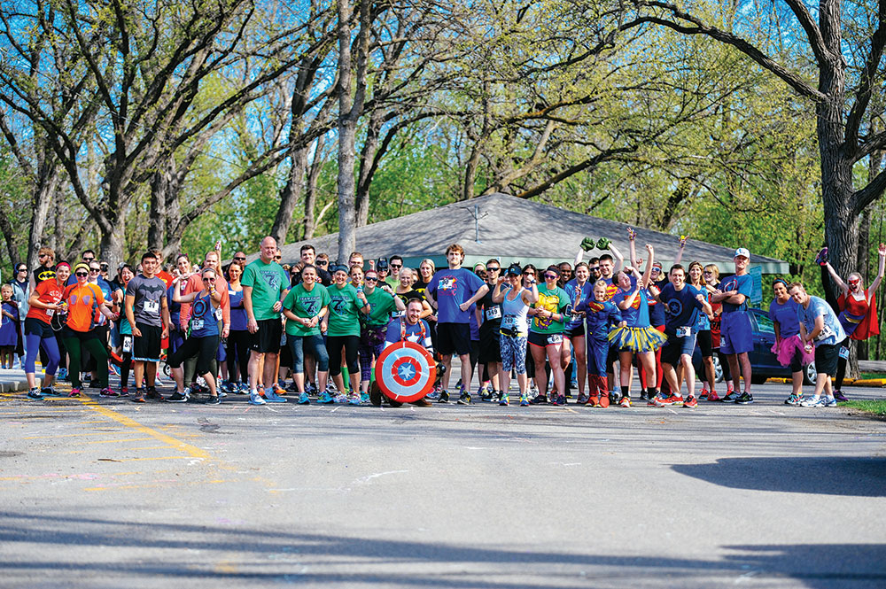 JOSEPH RAVITS | THE SPECTRUM Throngs of people lined up Saturday morning in Lindenwood Park for the Wish Fast races.