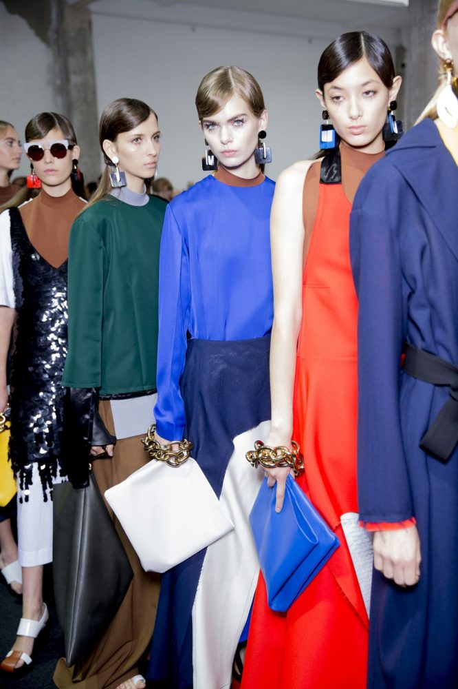 VOGUE.COM | PHOTO COURTESY  Models line up backstage for Marni's Spring 2016 runway show.