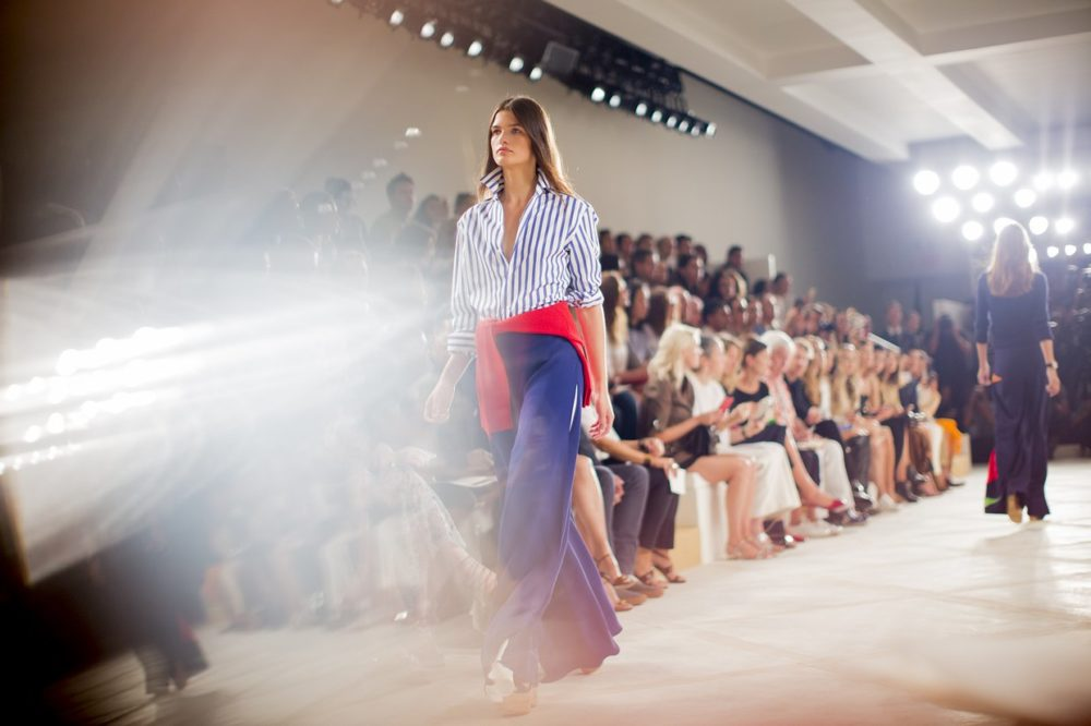 VOGUE.COM | PHOTO COURTESY Fashion insiders take in the latest Ralph Lauren collection.