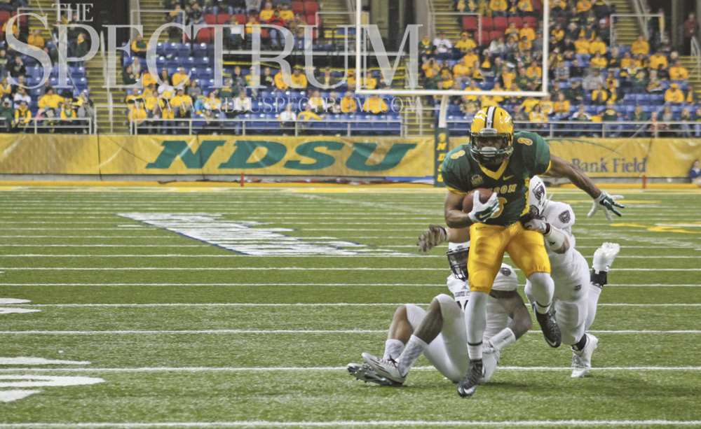 JULIA SATTLER | THE SPECTRUM Darius Anderson breaks away from two Missouri State defenders on senior day inside the Fargodome.