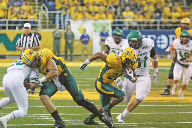 FILE PHOTO | THE SPECTRUM UND and NDSU played each other in football Sept. 19. UND will now be known as the Fighting Hawks following a vote.