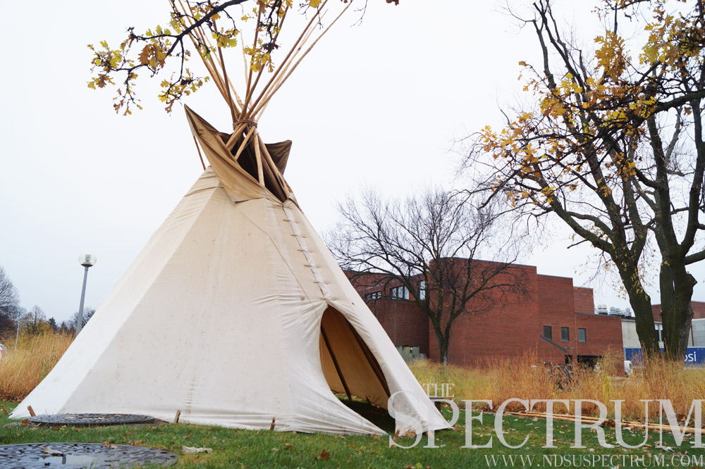 GABBY HARTZE | THE SPECTRUM  Volunteers set up a teepee for the opening ceremony, although it was rained out and moved to the Arikara room.