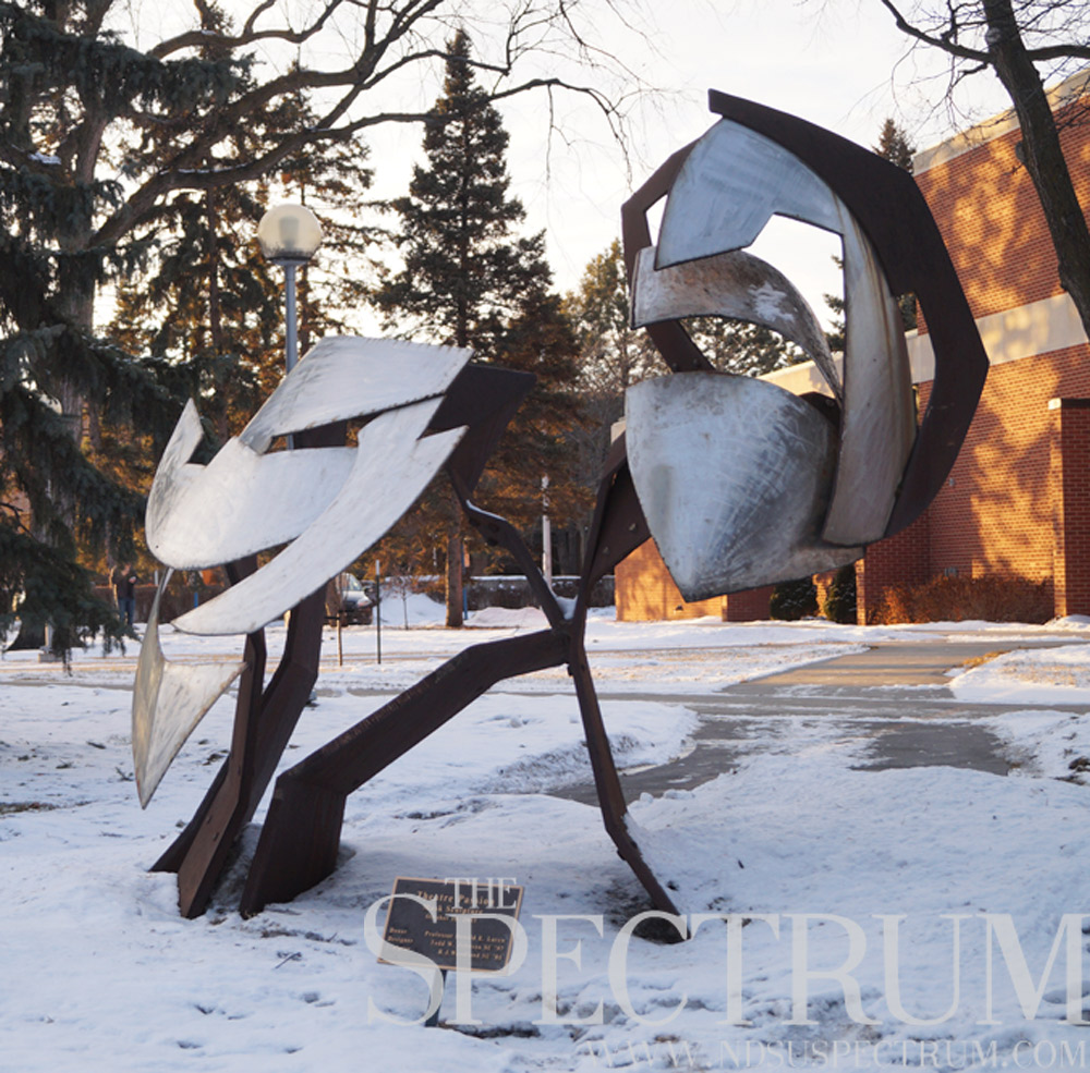 NDSU's Public Art on Campus program began in 2001. The theater mask sculpture outside Askanase Hall was installed as part of the program.