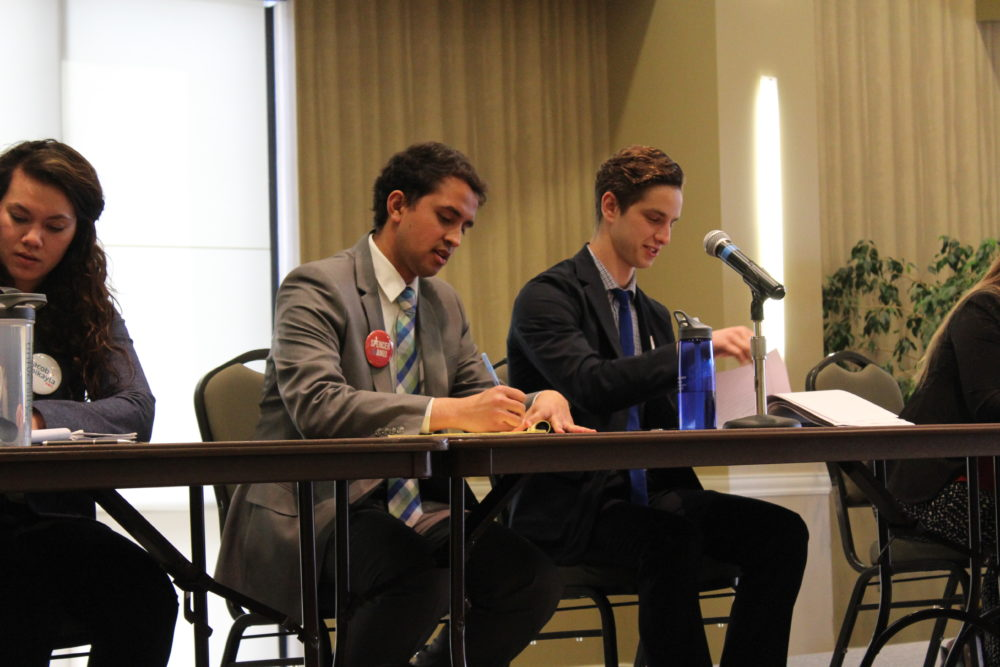 Spencer Moir (right) and Anuj Teotia (center) are running for student body president and vice president.