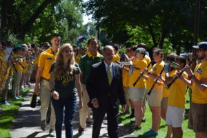 CASEY MCCARTY   THE SPECTRUM  President Dean Bresciani leads the class of 2020 through the gates of NDSU.