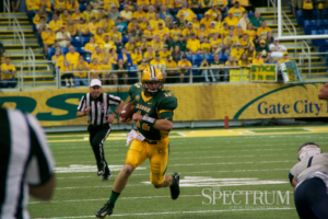 Easton Stick takes a QB sneak up the right hashes during Saturday's game. Stick and the Bison survived Charleston Southern 24-17.