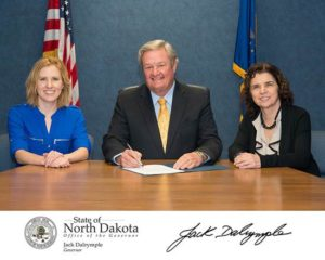 STATE OF NORTH DAKOTA Photo Courtesy | Governor Jack Dalrymple, Brenna Gerhardt and Beth Klingenstein officially designate October Arts & Humanities Month