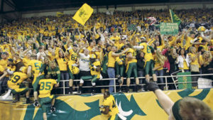 North Dakota State players rush the stands and celebrate with the student section after defeating Georgia Southern Friday, Dec.15, 2012, during the FCS playoff semifinals at the Fargodome. David Samson / The Forum