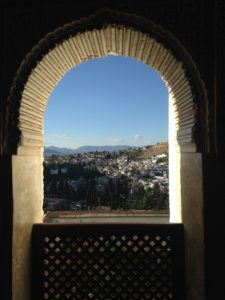 PHOTO COURTESY JORDYN MESKAN | View of Albaicín neighborhood through one of the Alhambra's horse shoe arch windows.